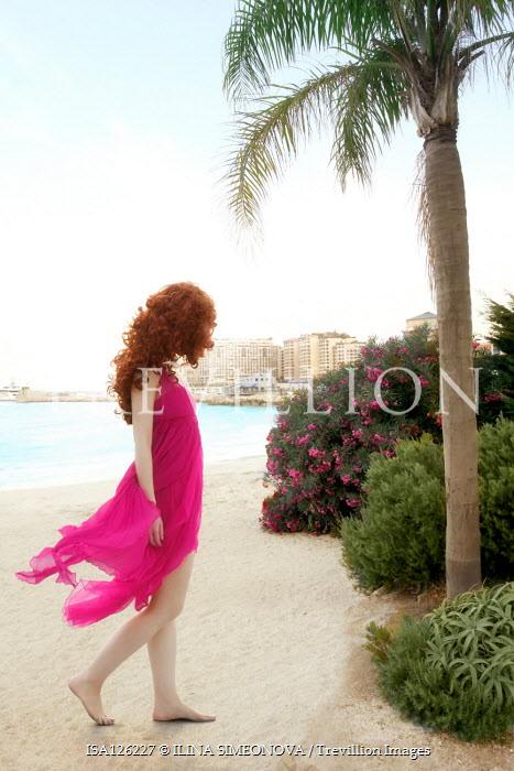 ILINA SIMEONOVA WOMAN WITH RED HAIR ON BEACH BY PALM TREE Women