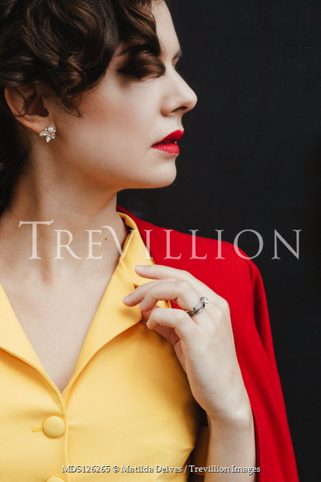 Matilda Delves BRUNETTE WOMAN IN YELLOW DRESS WITH RED JACKET Women