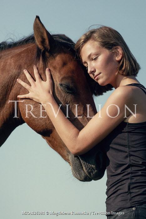 Magdalena Russocka close up of young girl hugging horse Women