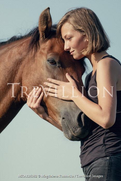 Magdalena Russocka close up of young girl hugging horse
