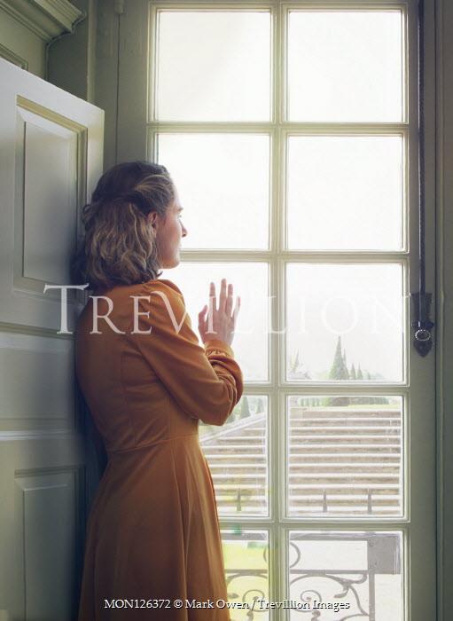 Mark Owen BLONDE WOMAN INDOORS BY WINDOW WATCHING GARDEN Women
