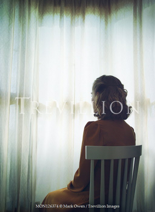 Mark Owen BLONDE WOMAN SITTING BY CLOSED CURTAINS Women