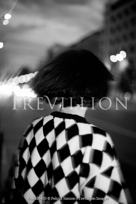 Felicia Simion WOMAN IN PATTERNED SWEATER IN CITY STREET AT NIGHT Women