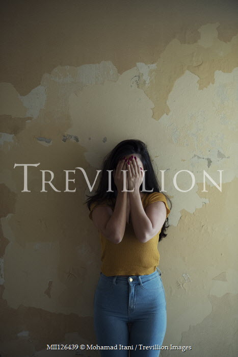 Mohamad Itani GIRL IN JEANS STANDING BY WALL CRYING Women