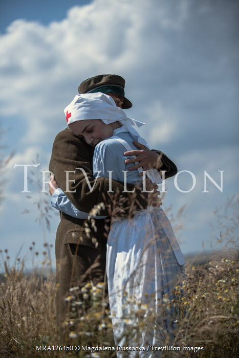 Magdalena Russocka wartime soldier and nurse hugging in field Couples