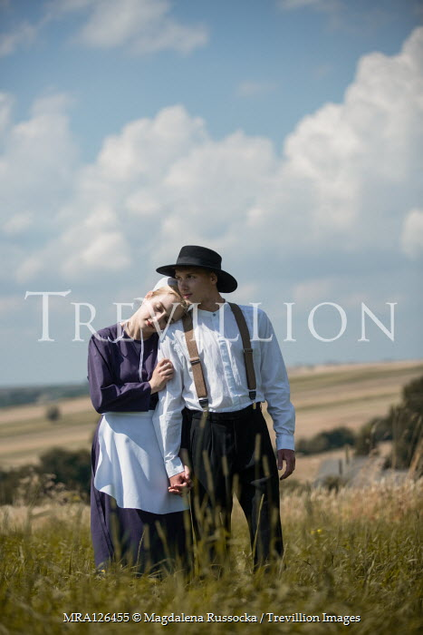Magdalena Russocka vintage amish couple hugging in field