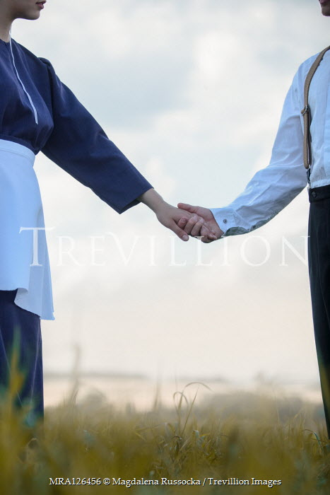 Magdalena Russocka AMISH COUPLE HOLDING HANDS IN COUNTRYSIDE Couples