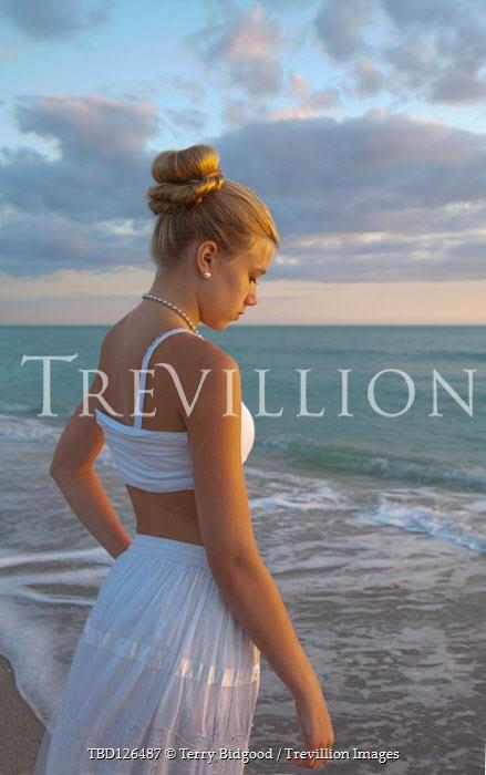 Terry Bidgood BLONDE GIRL IN WHITE WATCHING SEA AT DUSK Women