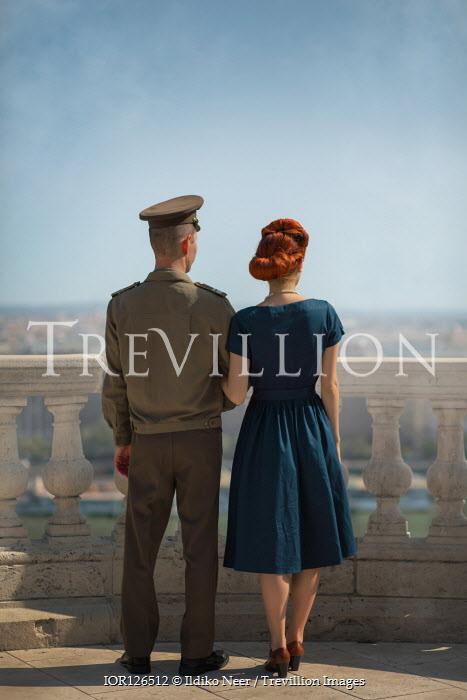 Ildiko Neer Wartime couple standing on balcony