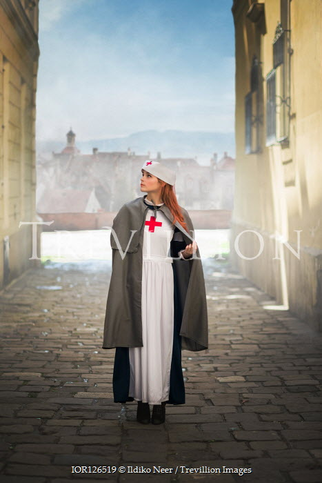 Ildiko Neer Historical wartime nurse standing in town