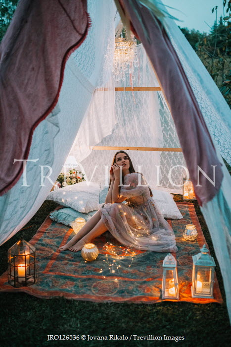 Jovana Rikalo GIRL SITTING IN TENT WITH RUG AND CANDLES Women