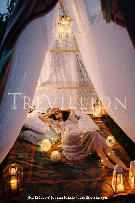 Jovana Rikalo GIRL LYING IN TENT WITH RUG AND CANDLES Women