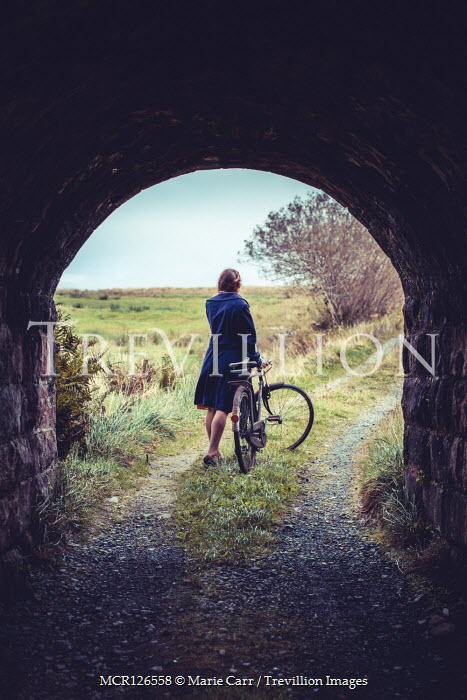 Marie Carr GIRL WITH BICYCLE ON COUNTRY ROAD BY TUNNEL Women
