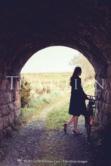 Marie Carr GIRL WITH BICYCLE IN TUNNEL ON COUNTRY ROAD Women