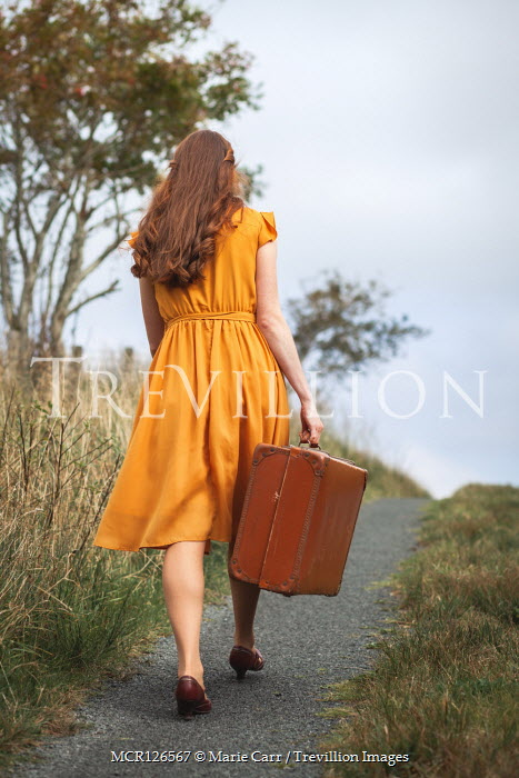 Marie Carr GIRL IN DRESS CARRYING SUITCASE ON COUNTRY ROAD Women