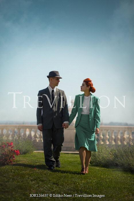 Ildiko Neer Vintage couple walking in garden