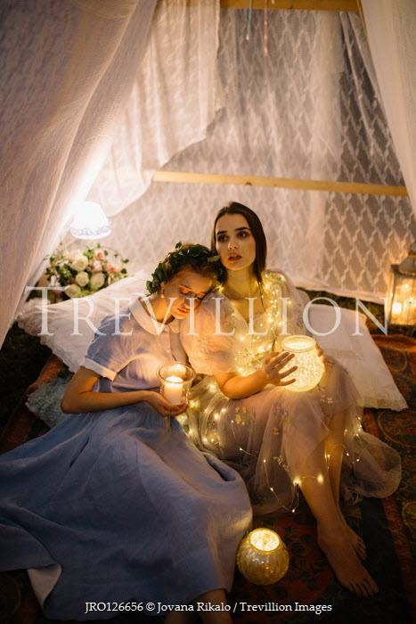 Jovana Rikalo TWO WOMEN HOLDING CANDLES INSIDE TENT Women