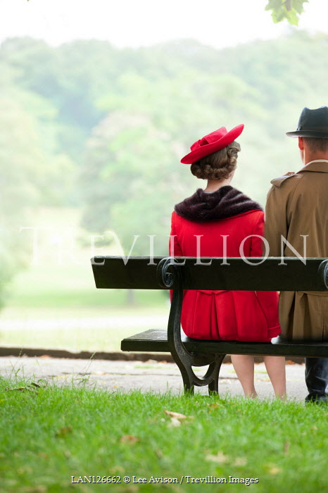 Lee Avison RETRO COUPLE SITTING ON BENCH IN PARK Couples