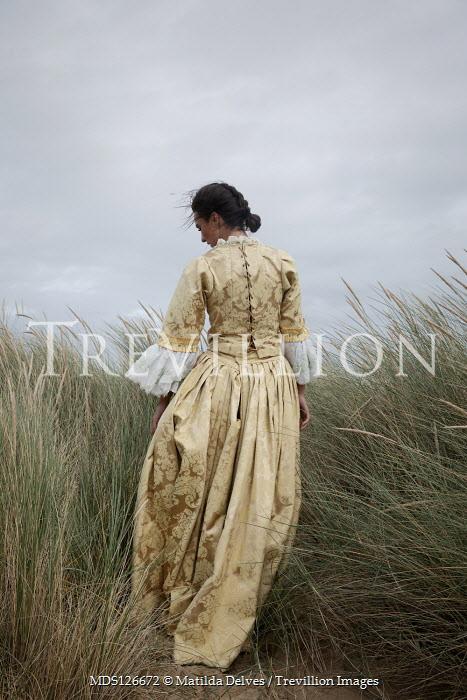Matilda Delves HISTORICAL BRUNETTE WOMAN STANDING IN SAND DUNE Women