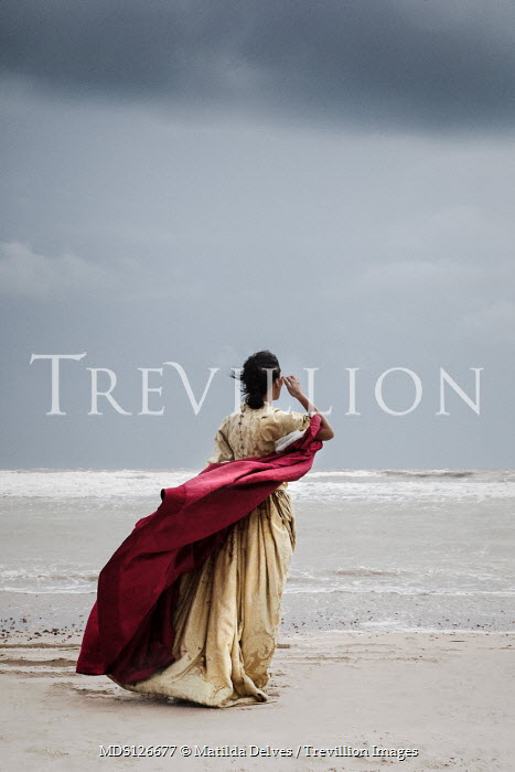Matilda Delves HISTORICAL WOMAN WITH CAPE ON BEACH WATCHING SEA Women
