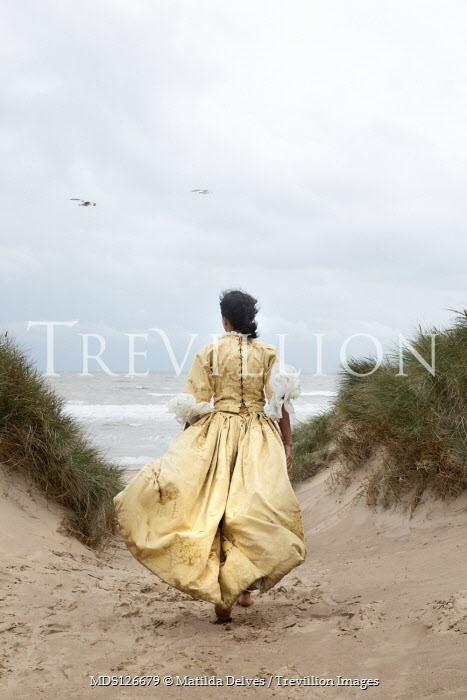 Matilda Delves HISTORICAL WOMAN RUNNING ON SAND DUNES Women