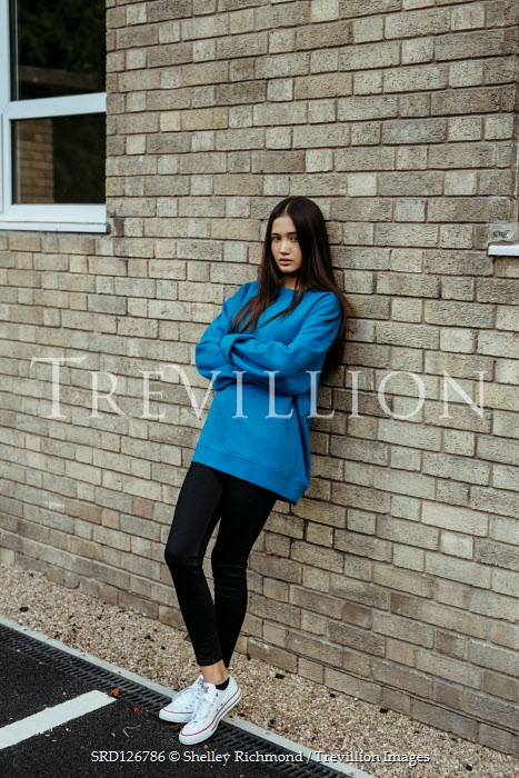 Shelley Richmond ASIAN TEENAGE GIRL LEANING ON BUILDING OUTDOORS Women