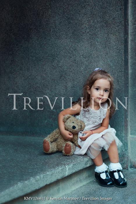 Kerstin Marinov CUTE LITTLE GIRL SITTING ON STEP WITH TEDDY BEAR Children