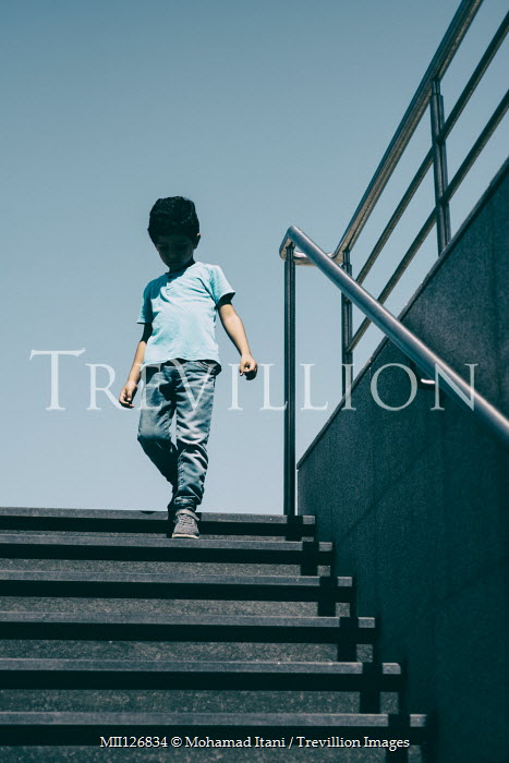 Mohamad Itani LITTLE BOY DESCENDING METAL STEPS OUTDOORS Children