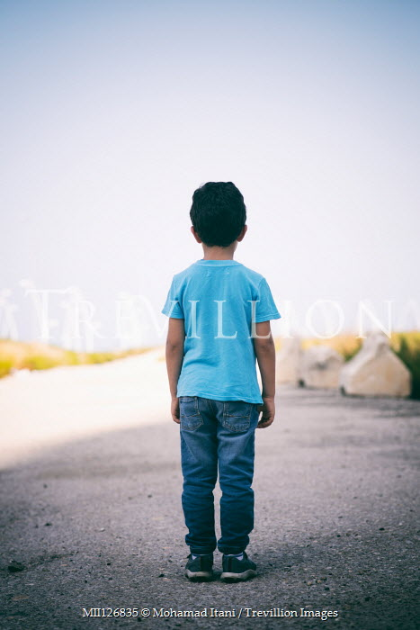Mohamad Itani LITTLE BOY STANDING ON COUNTRY ROAD IN SUMMER Children