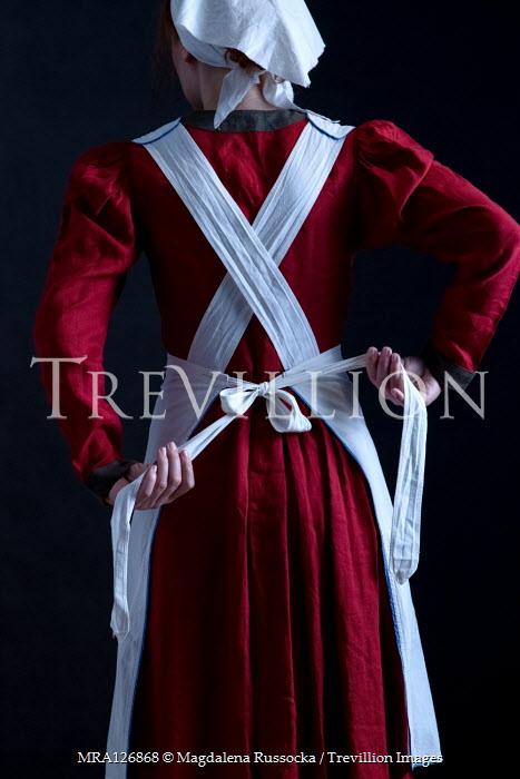 Magdalena Russocka historical maid untying apron inside