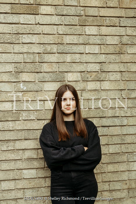 Shelley Richmond TEENAGE GIRL LEANING ON BUILDING OUTDOORS Women