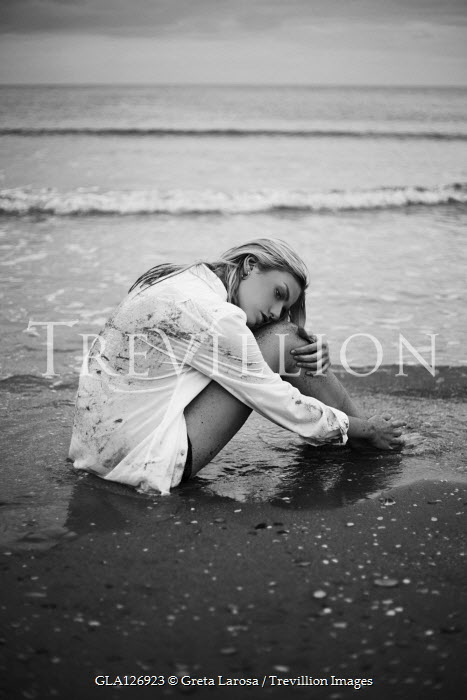Greta Larosa Young woman sitting on beach