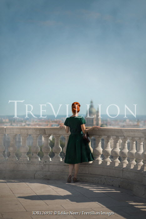 Ildiko Neer Vintage woman standing on terrace