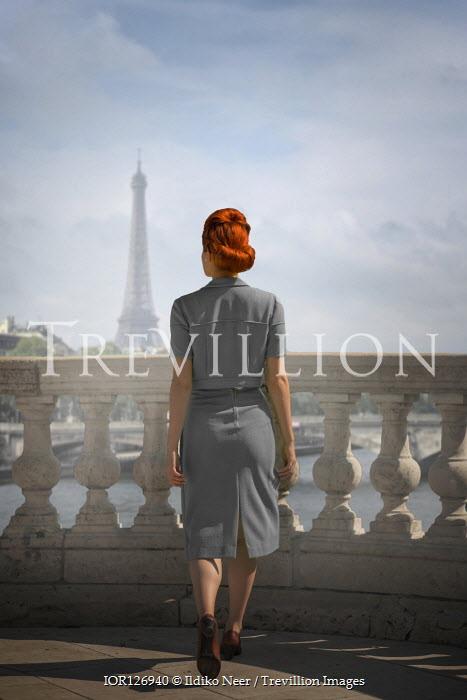 Ildiko Neer Vintage woman walking on terrace in Paris