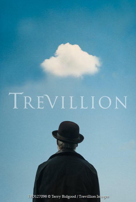 Terry Bidgood Man in bowler hat standing under cloud