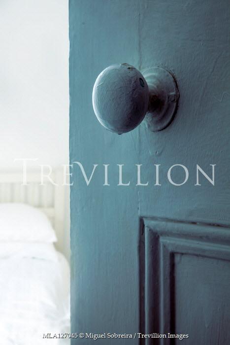 Miguel Sobreira Door knob on door to bedroom