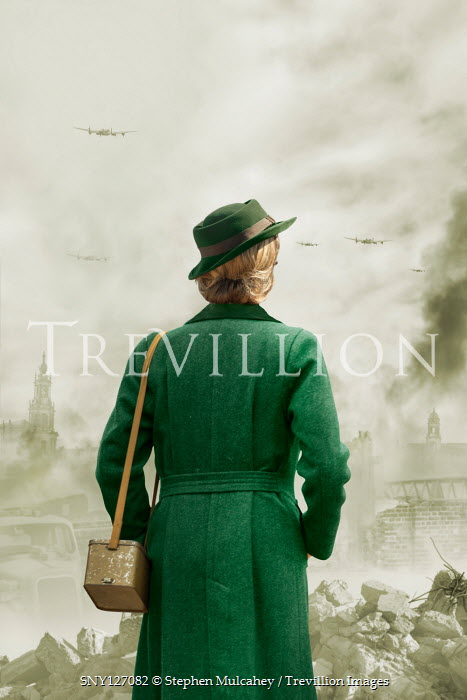 Stephen Mulcahey Young woman in green coat and hat during The Blitz in London, England
