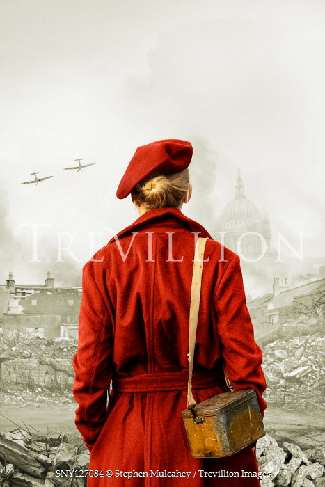 Stephen Mulcahey Young woman in red coat and beret during The Blitz in London, England