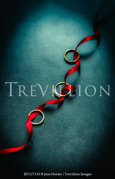 Jane Morley Wedding rings on red ribbon