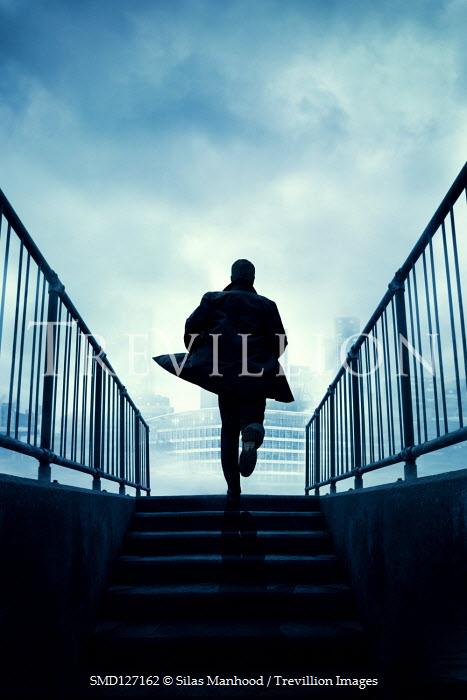 Silas Manhood MAN RUNNING UP STEPS IN CITY Men