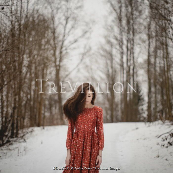 Dasha Pears Young woman in red dress in snowy forest