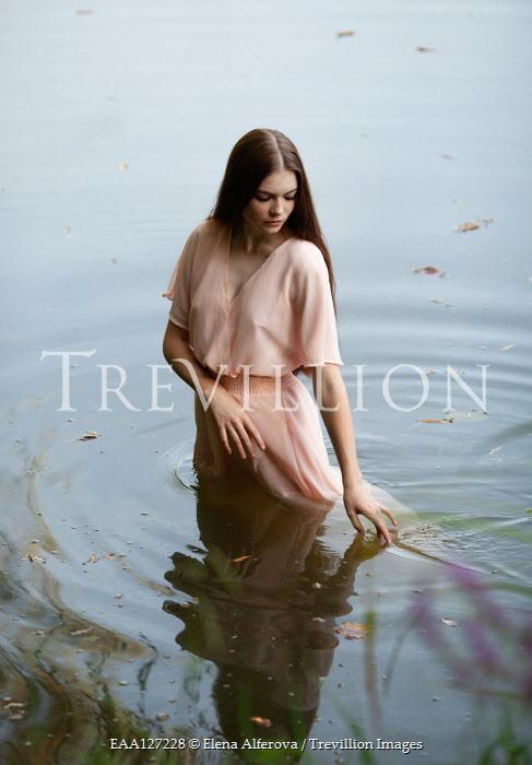 Elena Alferova Young woman in pink dress standing in river