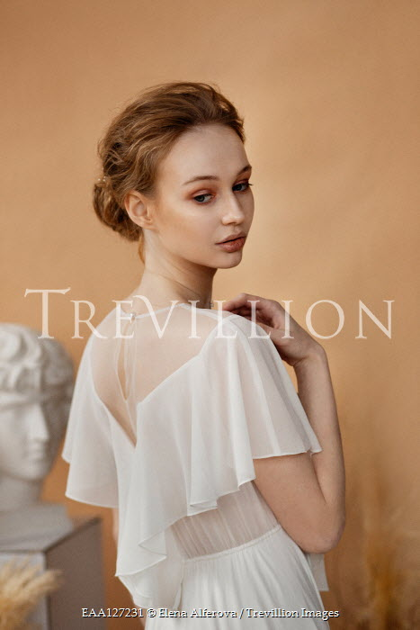 Elena Alferova Young woman in white dress