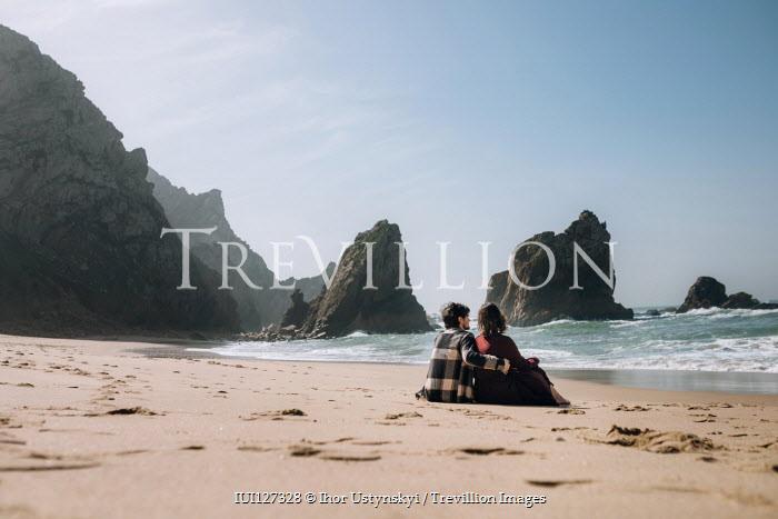 Ihor Ustynskyi COUPLE SITTING ON SANDY BEACH HUGGING Couples
