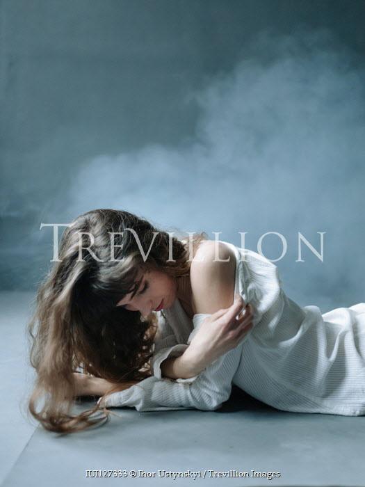 Ihor Ustynskyi BRUNETTE GIRL IN WHITE DRESS ON FOOR WITH SMOKE Women