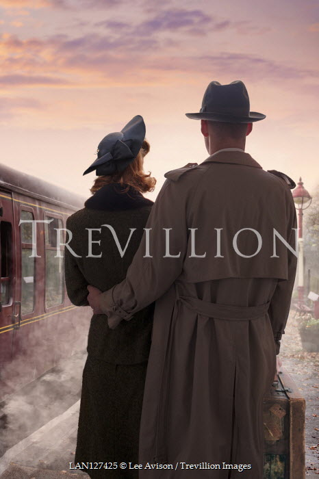 Lee Avison 1940S COUPLE WITH SUITCASE BY TRIN ON PLATFORM Couples