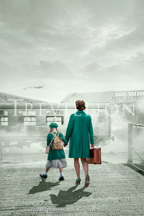 Stephen Mulcahey MOTHER AND DAUGHTER WITH SUITCASE AT TRAIN STATION Children