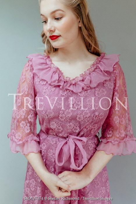 Shelley Richmond BLONDE WOMAN STANDING IN PINK LACE DRESS Women
