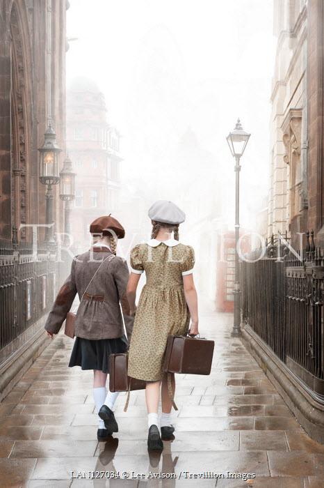 Lee Avison two anonymous 1940s girls walking with suitcases