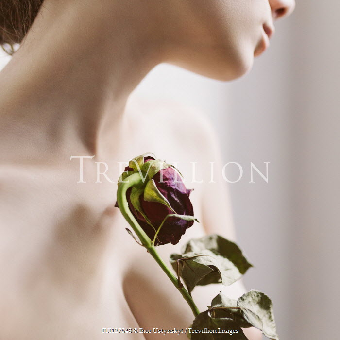 Ihor Ustynskyi Topless woman holding rose